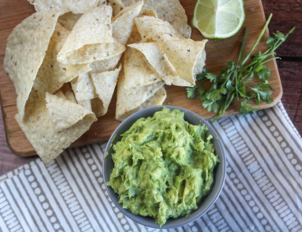 overhead view of guacamole and chips
