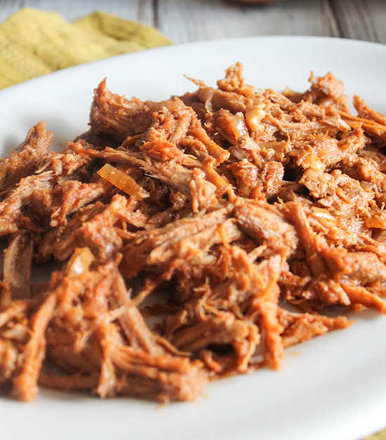 shredded pork on a white plate