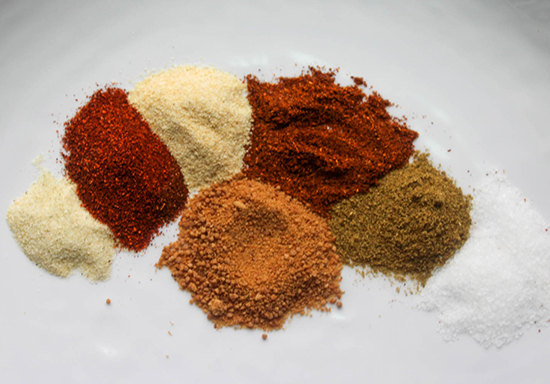 Homemade spice rub ingredients on a plate