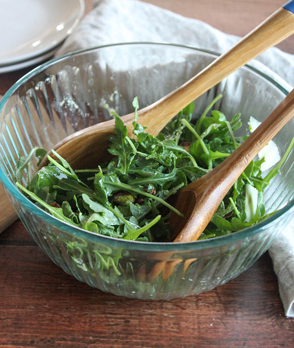 Baby arugula salad in a glass bowl
