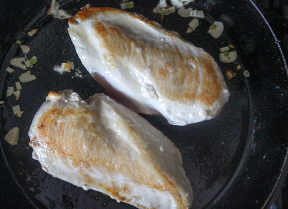 A picture of the chicken breasts seared until golden brown