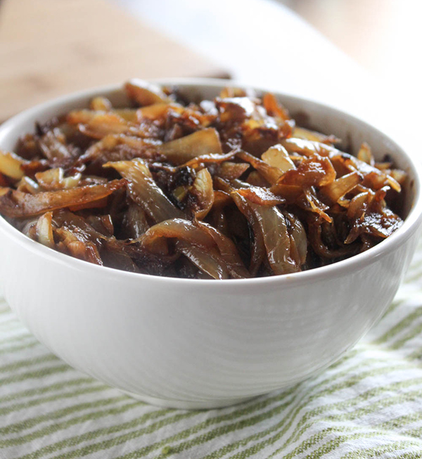 a close up picture of caramelized onions