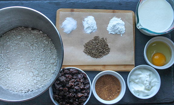 The ingredients: flour, raisins, coconut sugar, yogurt, egg, buttermilk, caraway seeds, baking powder, baking soda and salt