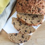 whole wheat irish soda bread on a cutting board