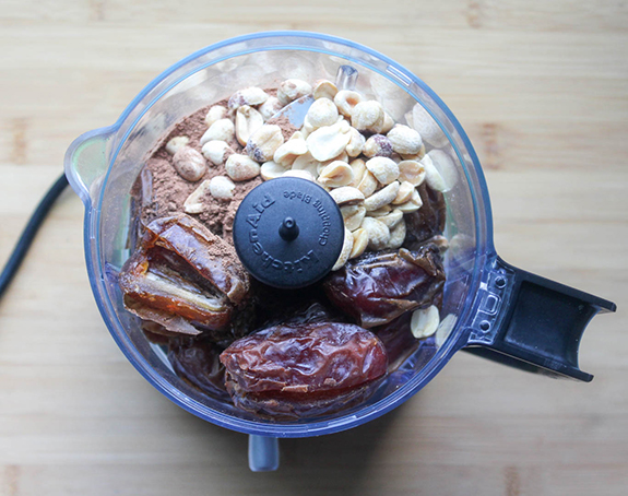 the ingredients, peanuts, dates, coco powder in a food processor bowl