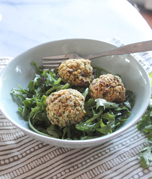 Falafel balls in a bowl with greens
