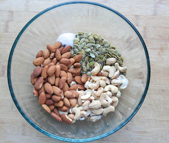 the ingredients in a bowl, almonds, cashews pepitas, sea salt