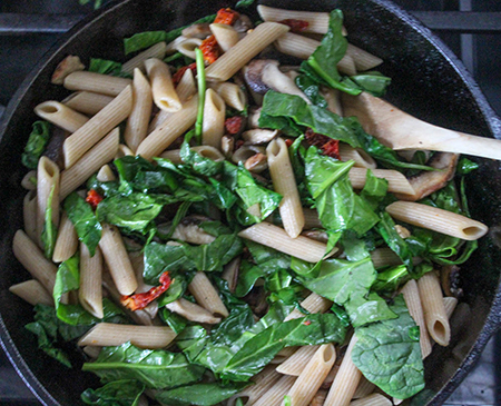 pasta spinach and mushrooms in a pan