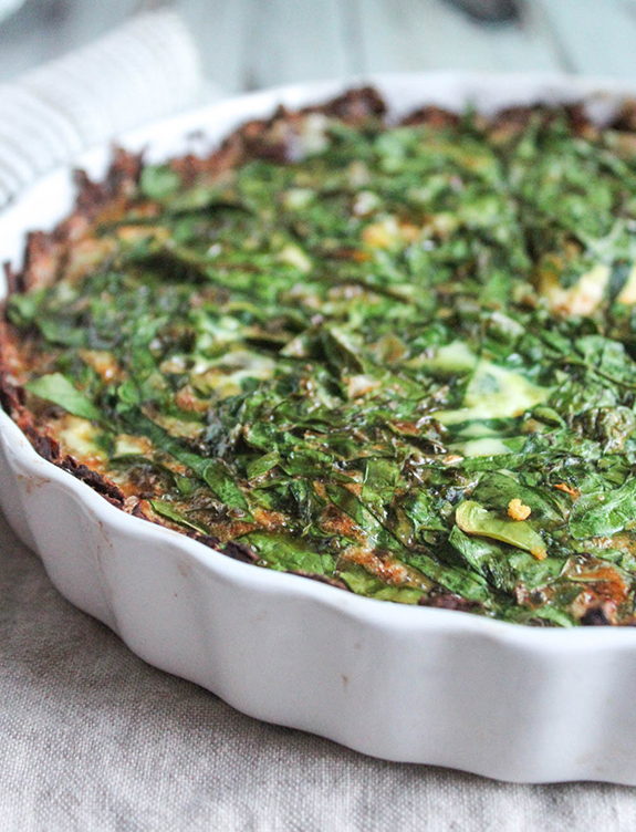 spinach Mediterranean quiche close up in a pie plate