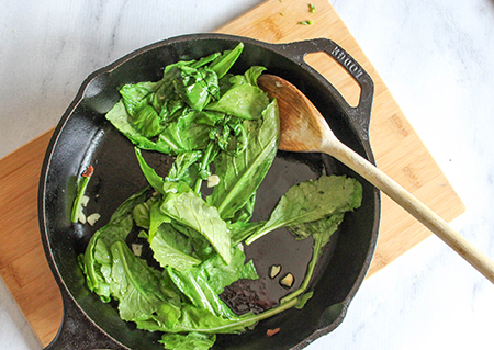 wiltedgreens in a cast iron pan