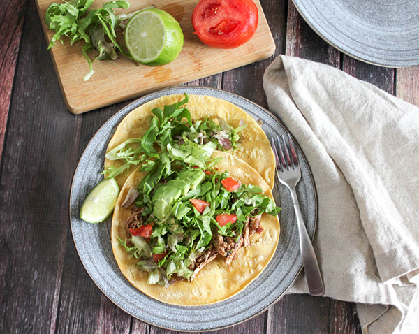 Overhead view of tostadas on a plate with a fork