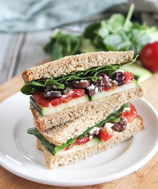 mediterranean vegetable sandwich stacked on a plate