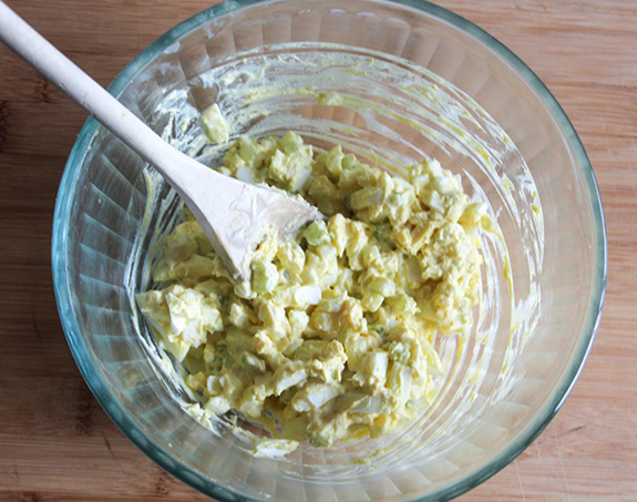egg salad ingredients mixed together in a bowl