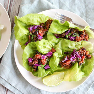 an overhead view of taco lettuce wraps on a white plate