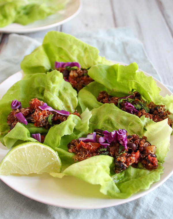 Vegetarian taco lettuce wraps on a plate with lime slices