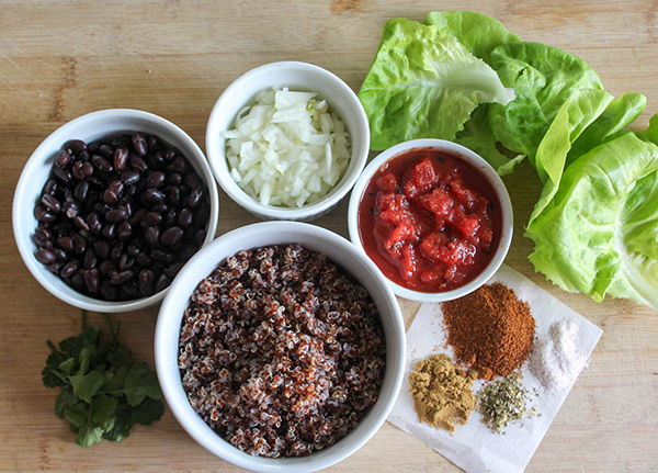 The ingredients, black beans, quinoa, cilantro, spices, tomatoes, onions and lettuce