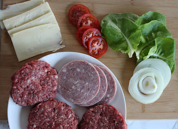 the ingredients: burgers, pork roll, tomatoes, lettuce, onion, cheese