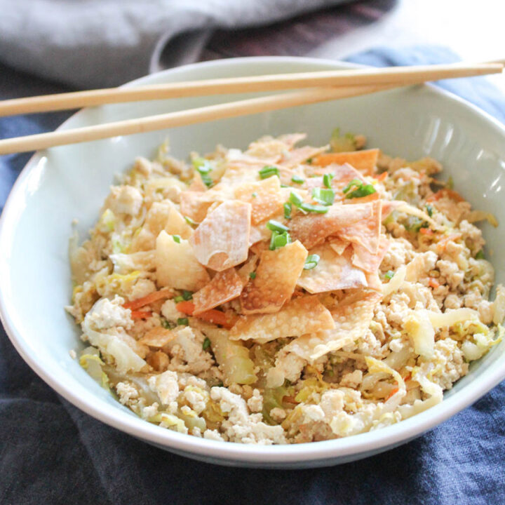 egg roll in a bowl with chop sticks