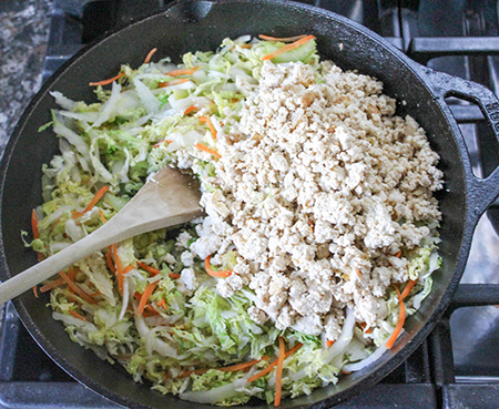 vegetables and crumbled tofu in a pan