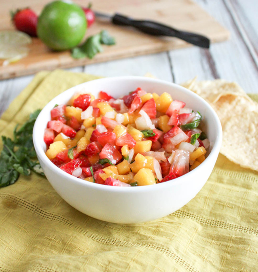 a bowl full of mango and strawberry salsa