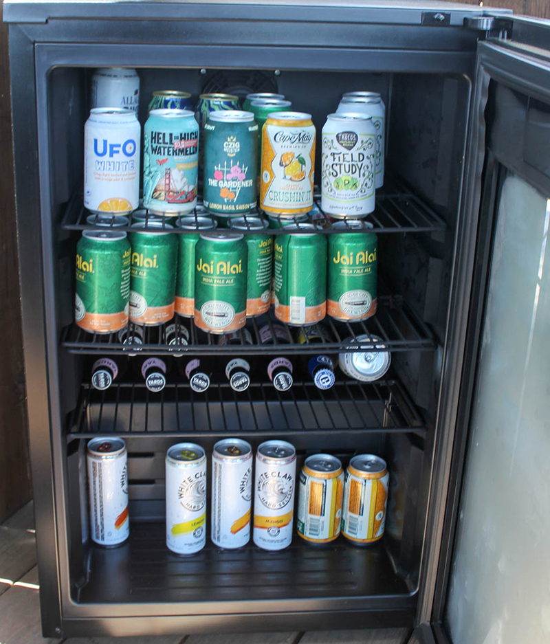 an open refrigerator with beer in it