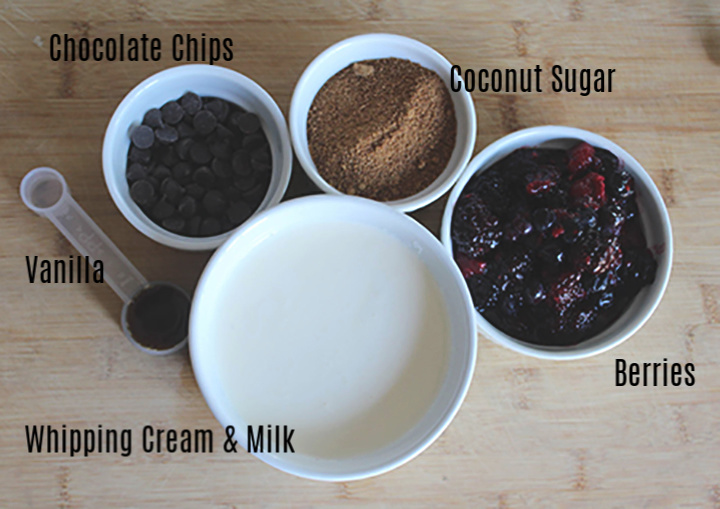 The ingredients: chocolate chips, coconut sugar, vanilla, whipping cream and milk, berries