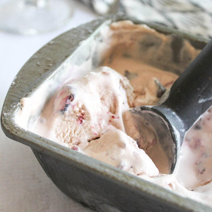 a close up of ice cream in a pan with a scoop