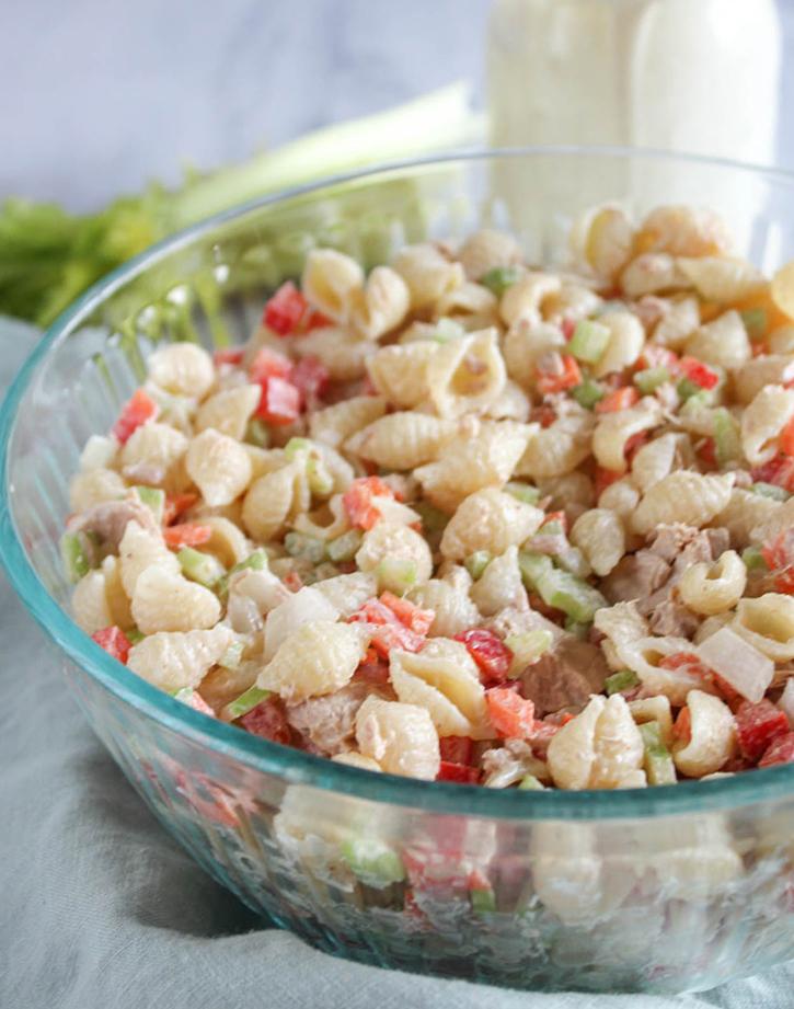 Healthy macaroni salad with tuna in a blass bowl