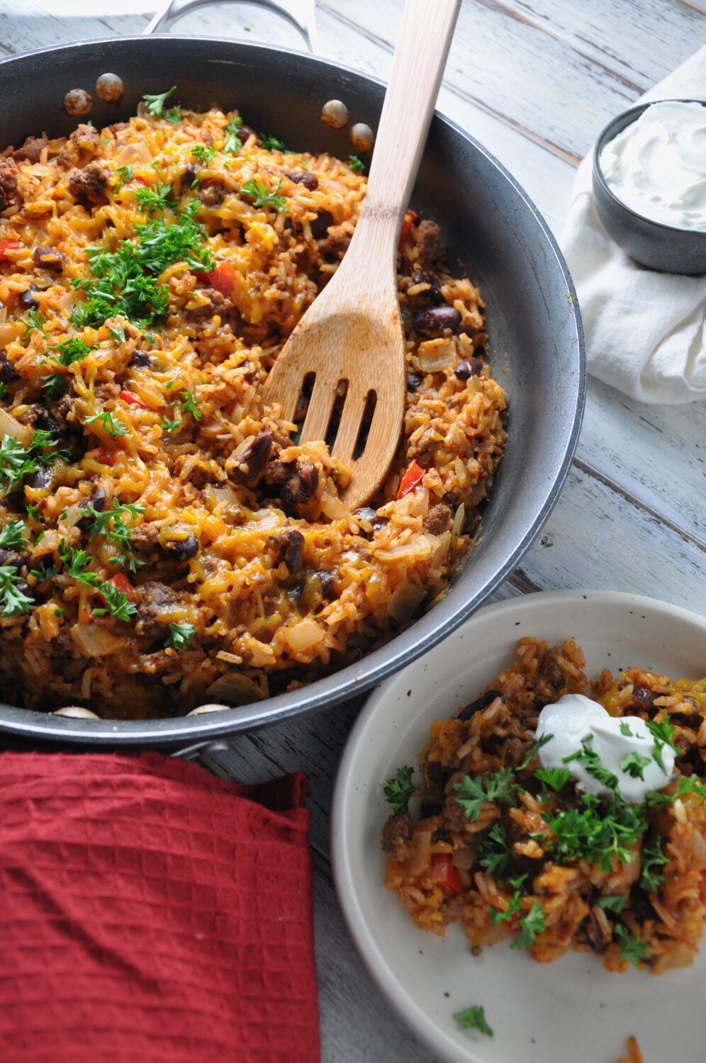 a skillet full of cheesy beef and rice