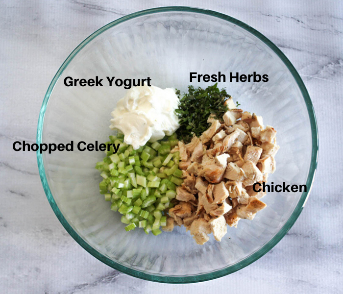 The ingredients in a bowl: Greek Yogurt, Fresh Herbs, Chicken, Chopped celery