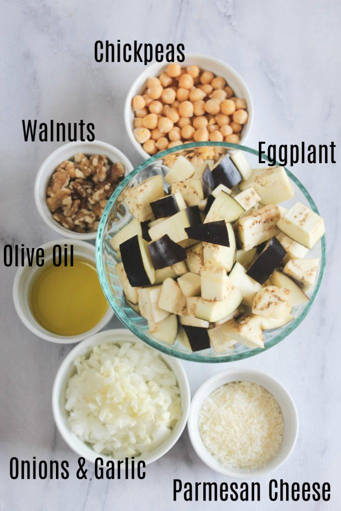 The Ingredients overhead view, chickpeas, walnuts, Olive Oil, onions & garlic, parmesan cheese,  eggplant chunks
