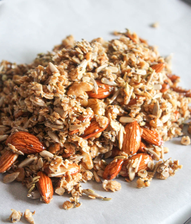 a pile of granola on a baking sheet