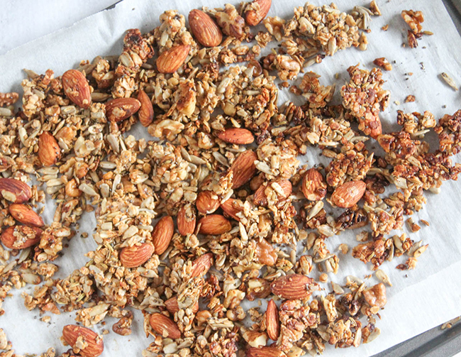 an overhead veiw of baked granola on a baking sheet