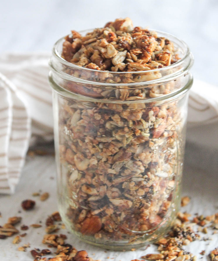 a mason jar filled with granola