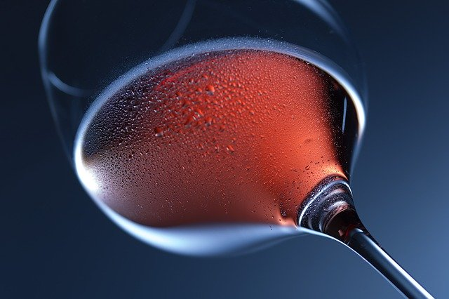 a glass of chilled rose wine looking from the bottom up