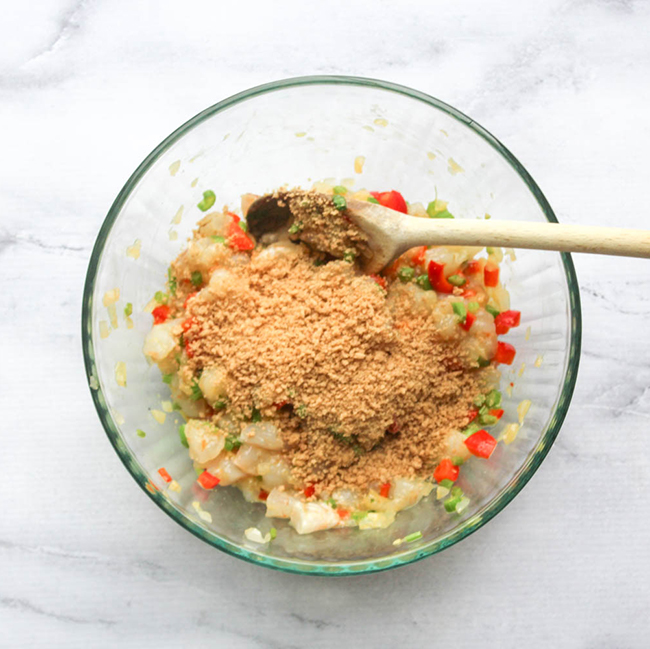 bread crumbs on top of the shrimp mixture in a bowl