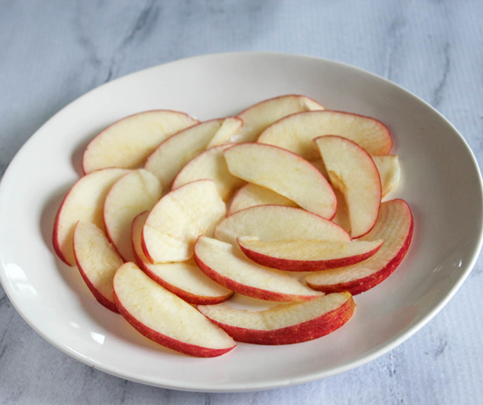 sliced apples on a white plate
