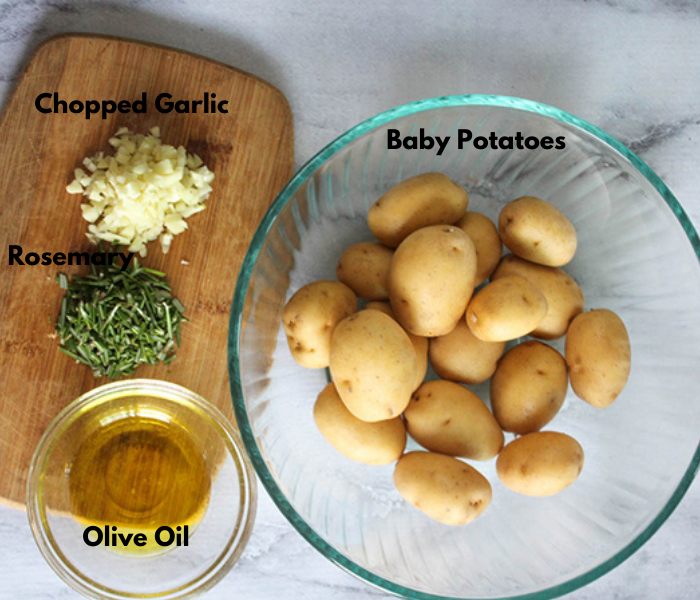 The ingredients: chopped garlic, rosemary olive oil and baby potatoes