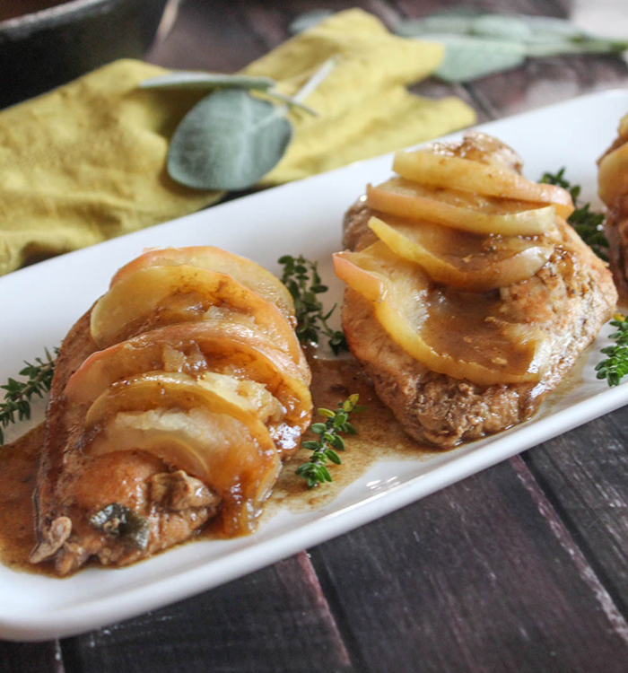baked chicken cutlets with sliced apples on top
