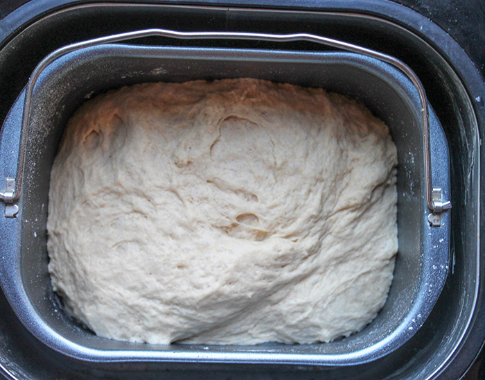 the dough after it has gone through the bread machine, mixed together and leavened
