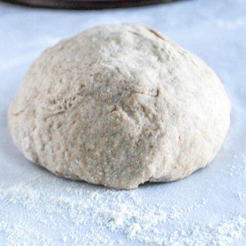 a close up of a pizza dough ball