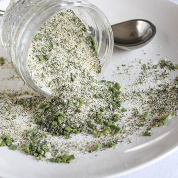 ranch season pouring out of a jar onto a white plate