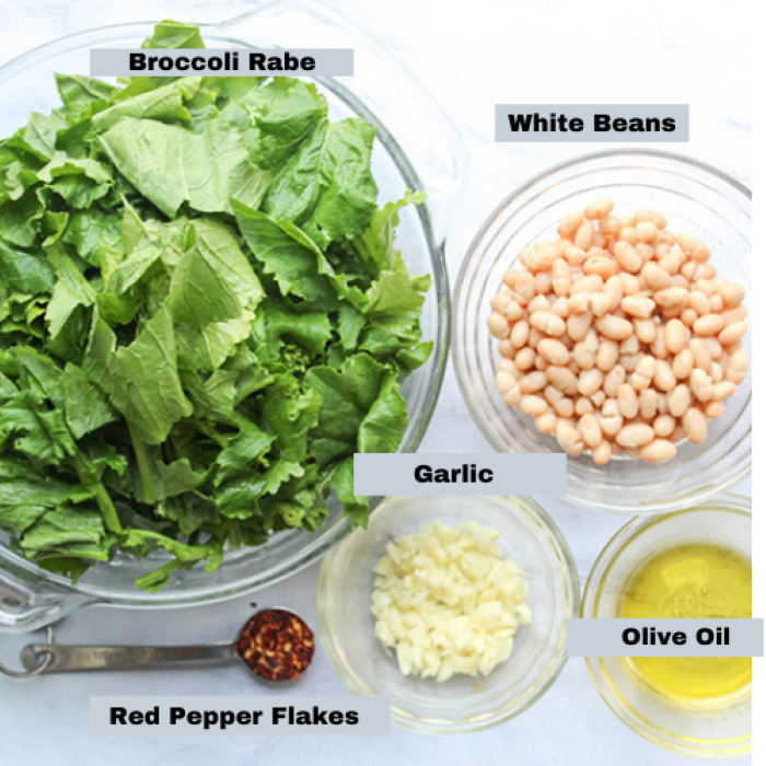 an overhead view of the ingredients in separate bowls: broccoli rabe, red pepper flakes, chopped garlic, olive oil, white beans