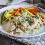 crack chicken on a plate with carrots and zucchini