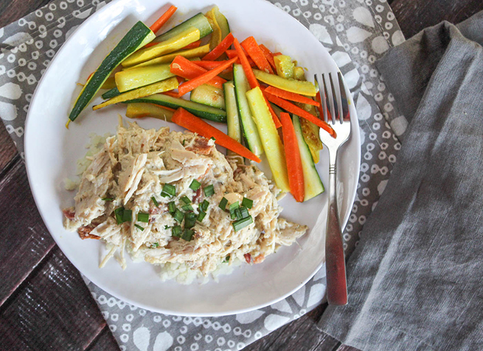 crack chicken on a plate with strips of zucchini and carrots
