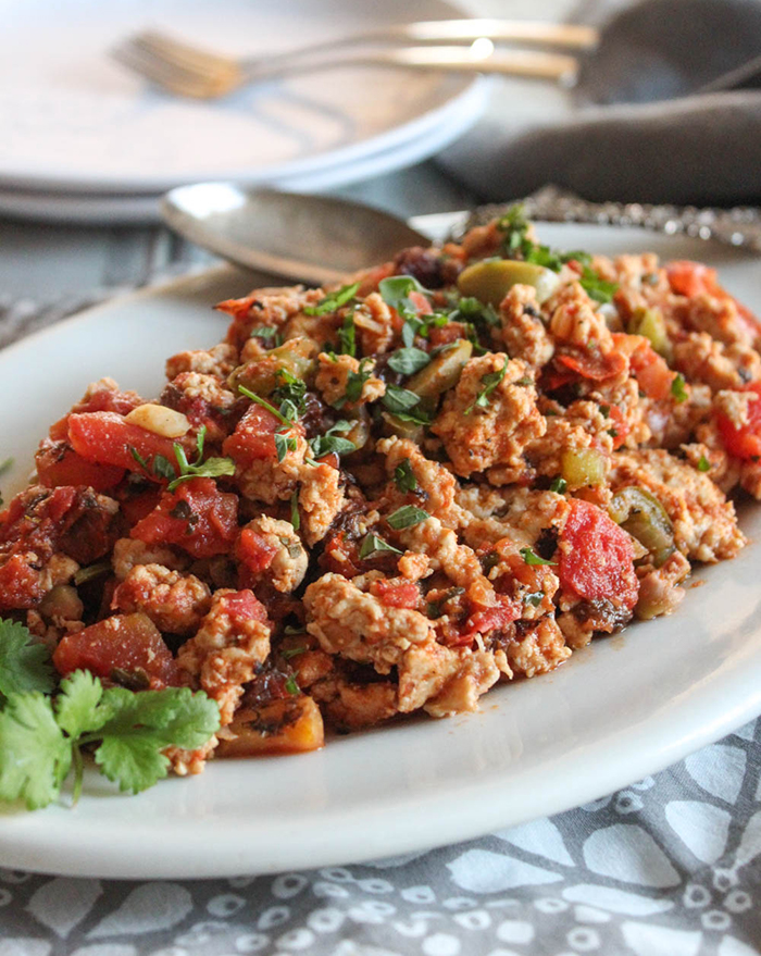 chicken picadillo on a plate with a spoon