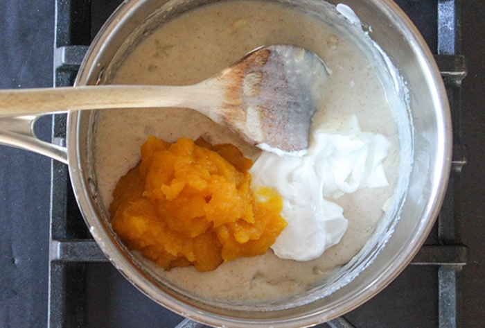 the cream sauce with yogurt and pumpkin puree in a pan