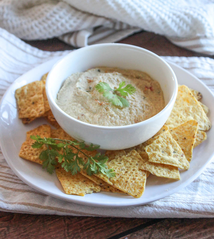 vegan queso in a bowl with chips
