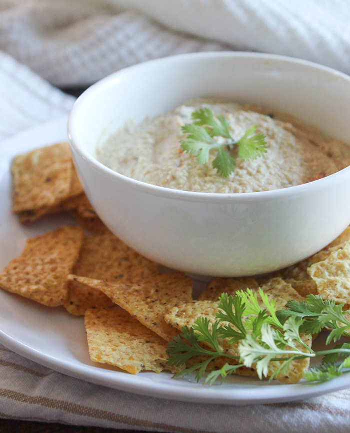 vegan queso dip in a bowl with cilantro on top