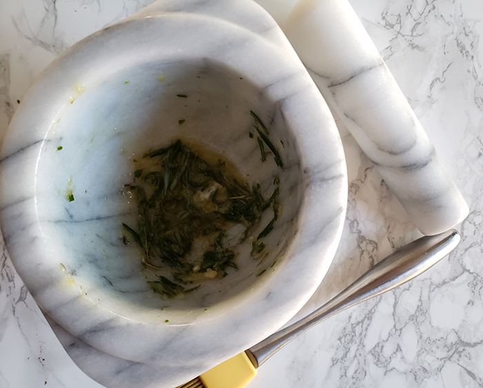 fresh rosemary, garlic and oil in a bowl